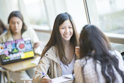 Female student smiling at friend