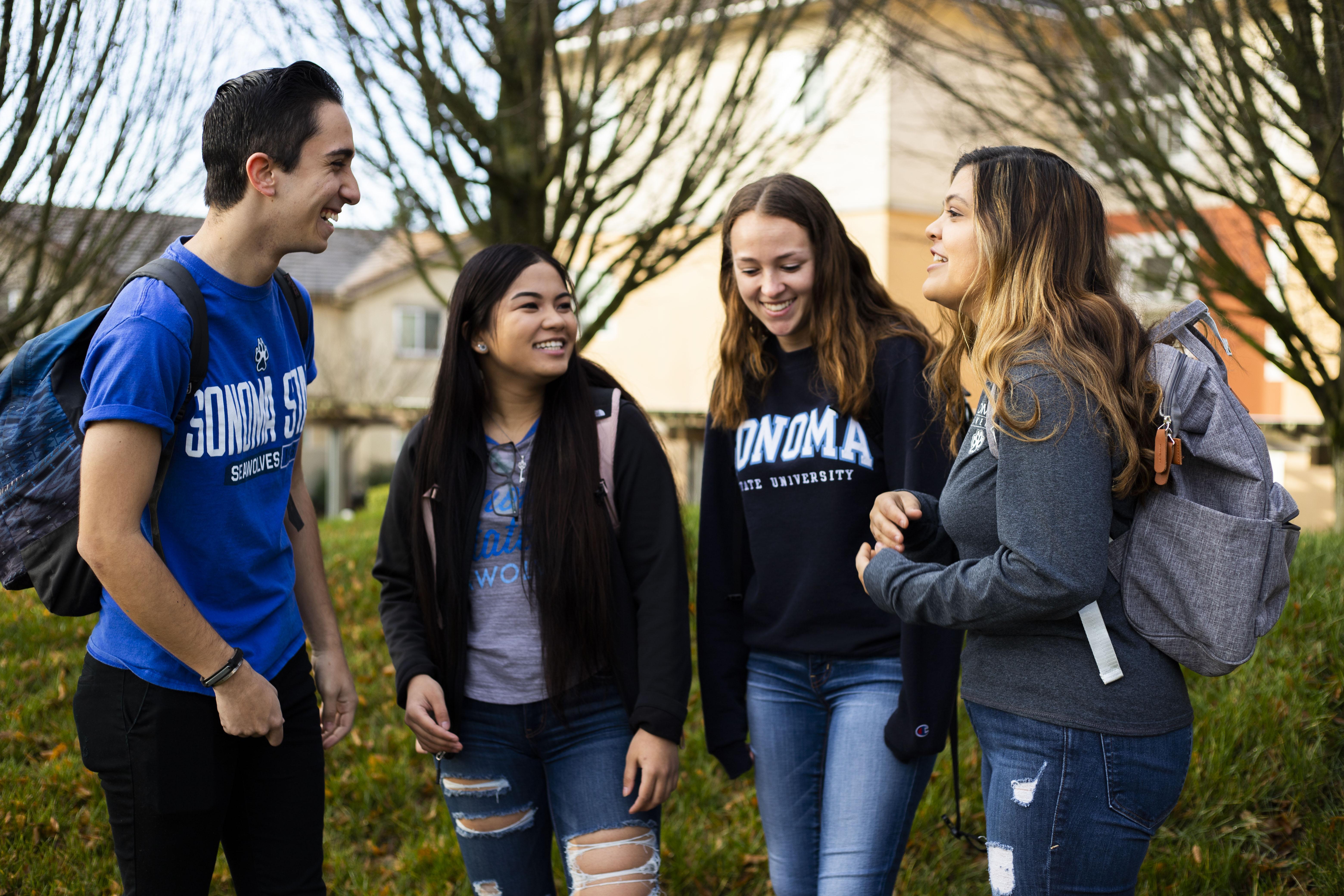 Four Students Talking in SSU Logo