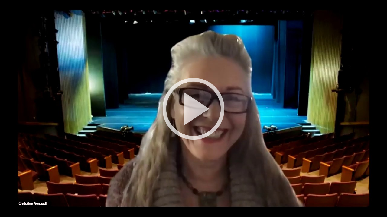School of Arts & Humanities faculty member in front of Person Theatre background with video play button